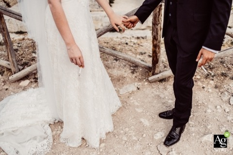 Sicily Wedding Photographer | Image contains: detail shot, bride, groom, dress, tuxedo, outdoors,hands