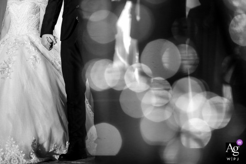 Guangdong pictures by a creative wedding photographer | detail of bride and groom holding hands