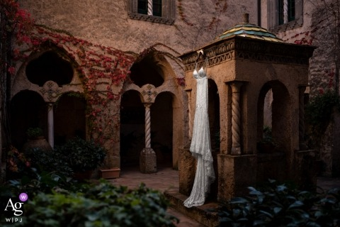 Florence artistic wedding photography dress detail | gown hanging outside in good natural light