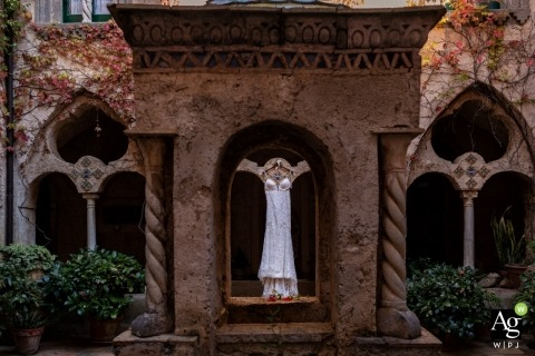 Florence Documentary Wedding Photographer | Image contains: garden, wedding dress, detail shot, stone arches