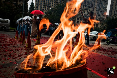 Fuzhou China Wedding Photography | Image contains: umbrella, detail shot, fire, city streets