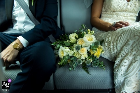 Camp Hale, Vail artistic creative photography detail of groom and bride with bouquet in car