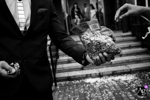 London artistic wedding photography details | handing reaching for a bag