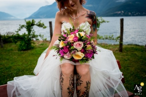 Como Italy picture by a creative wedding photographer | detail of bride with her bouquet on the lake