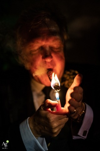 London Wedding Reportage Photographer | Image contains:  cigar, suit, guest, candle, night