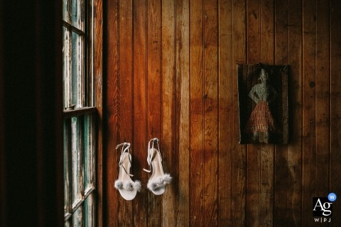 Boston pictures by a creative wedding photographer | detail of shoes hanging by a window on a rustic wall
