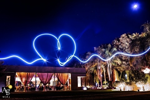 Playa del Carmen artistic wedding photography details | long shutter with light heart in blue