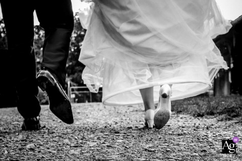 NRW artistic wedding photography details | bride and groom feet walking away