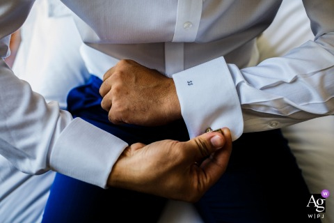 China pictures by a creative wedding photographer | detail of groom putting on cuff links
