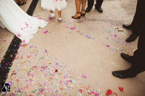 Slovenia pictures by a creative wedding photographer | detail of dress dragging through confetti on floor