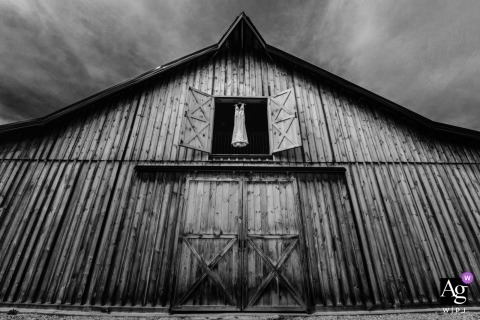 Alberta artistic creative, black and white photography detail of dress hanging in the hay door of a barn