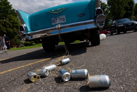 Cans ties to wedding car
