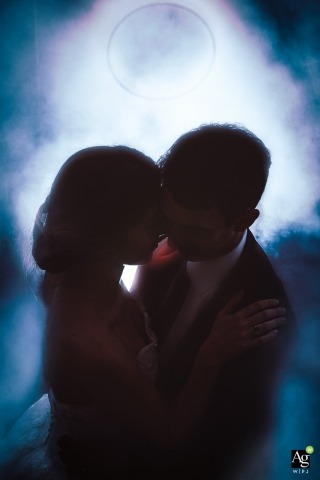 Orivieto Wedding Photographer | Image contains: groom, portrait, bride, overhead shot, blue lights, embracing