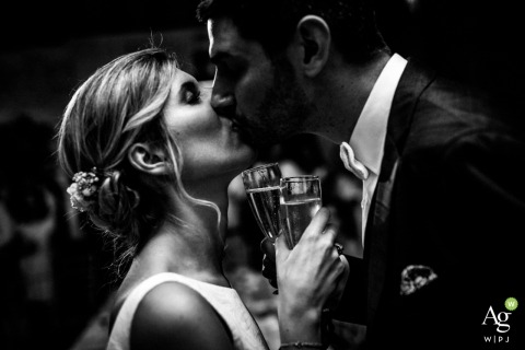 Paris Fine Art Wedding Portraits | Image contains: bride, groom, portrait, black and white, champagne, kissing, toasting
