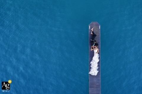 wedding on the sea | drone portrait of couple on the sea dock on the water