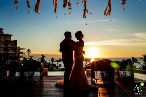 Puerto Vallarta Wedding Photo Fine Art -  Image contains: bride, groom, silhouette, portrait, dancing, sunset, ocean, dress, tuxedo