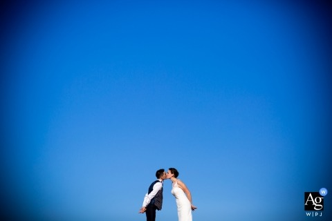 creative wedding day portrait session with a Tuscany bride and groom with a huge blue sky