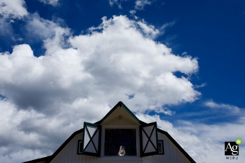 Artistic wedding photography from Colorado of a couple framed within barn doors
