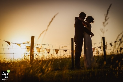 Dorset, England wedding photographer captured this image of couple in field