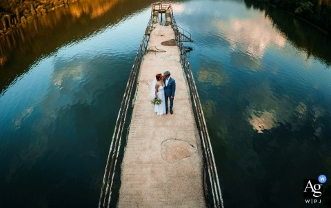 Wedding on the lake, Sofia | The sky is below us - couple on dock with lake and reflected clouds and sky