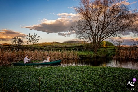 artistic wedding photo during Maryland portrait session with bride and groom in a canoe