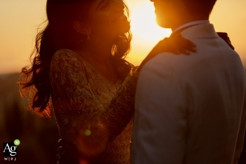 Tuscany creative wedding portrait photography of bride and groom at sunset - warm and good
