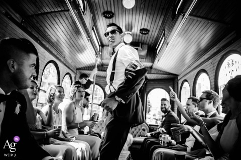 Chicago wedding photography portrait in wedding bus with the bridal party in black and white