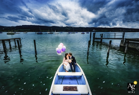 Switzerland creative wedding portrait photography in a boat with balloons