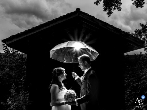 Switzerland artistic wedding pictures of a couple with an umbrella