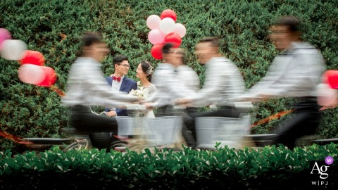 Beijing creative wedding portrait photography | bridal party on bikes with balloons