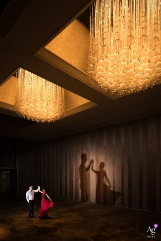 Wedding portrait of the couple dancing with a shadow cast on the wall in Beijing