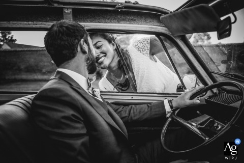 France creative wedding portrait photography of bride and groom behind the steering wheel of a vintage car