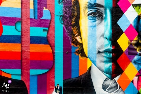 Bride and Groom Portrait | lost in Bob Dylan Mural in Minneapolis