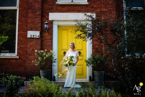 Burlington wedding photography portrait of bride standing by yellow door by a New England photographer available for VT, NH, MA and CT weddings.