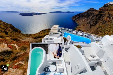 Wedding in Santorini with portrait of bride and groom above with pool
