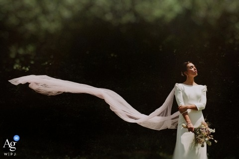 Gipuzkoa portrait photo shoot session of bride outdoors with flowing veil in the wind