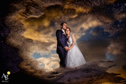 Baden-Wurttemberg wedding day couple portrait | puddle reflection of bride and groom