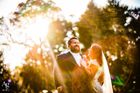 Sunny day portrait of bride and groom on wedding day by Johnny Shryock of Arlington Virginia