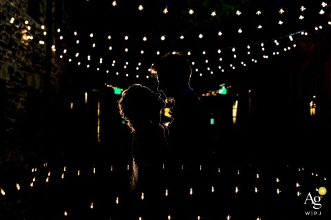 Virginia wedding photographer artistic portrait of a rim-lit couple with fairy lights