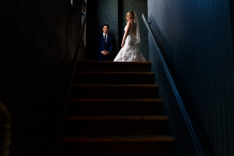 Wedding couple in dark staircase at Chateau St-Ambroise, Montreal