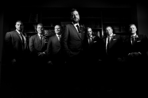 Dramatic groomsmen group wedding photo
