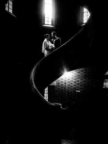 Bride & Groom have a moment on the spiral staircase