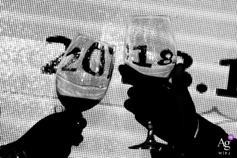 Guangzhou wedding detail of two wine glasses held up and shadowed
