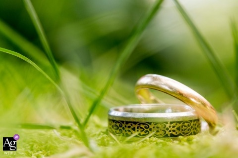 Lake Tahoe creative wedding photography | detail of rings in the grass