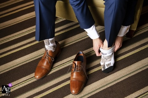 Boston artistic wedding photo detail of groom putting on wedding shoes
