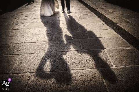 Italy artistic wedding photo detail of bride and groom's shadow on sidewalk