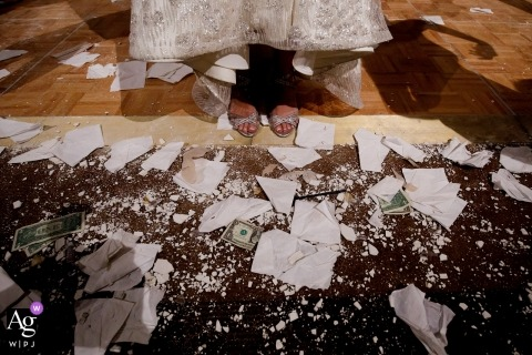 Denver creative wedding photography | detail of bride's feet, broken plates and money on floor