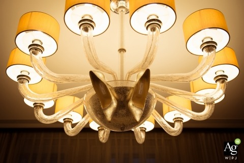 Hong Kong creative wedding photography | detail of shoes in lighting fixture