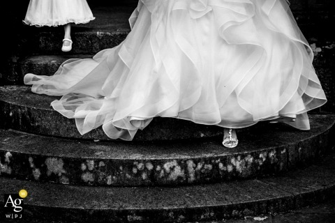 England Bride and daughter coming down stairs | detail wedding photo of dress and shoes