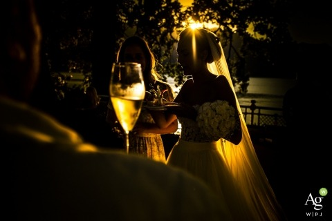 Lecco artistic creative photography detail of wine glass with bride in the background